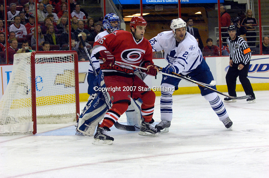 Carolina Hurricanes' Andrew Ladd (16) is pushed in the crease by the Toronto Maple Leafs' Hal Gill as goalie Andrew Raycroft watches Tuesday, Jan. 30, 2007 at the RBC Center in Raleigh. The Leafs won 4-1.