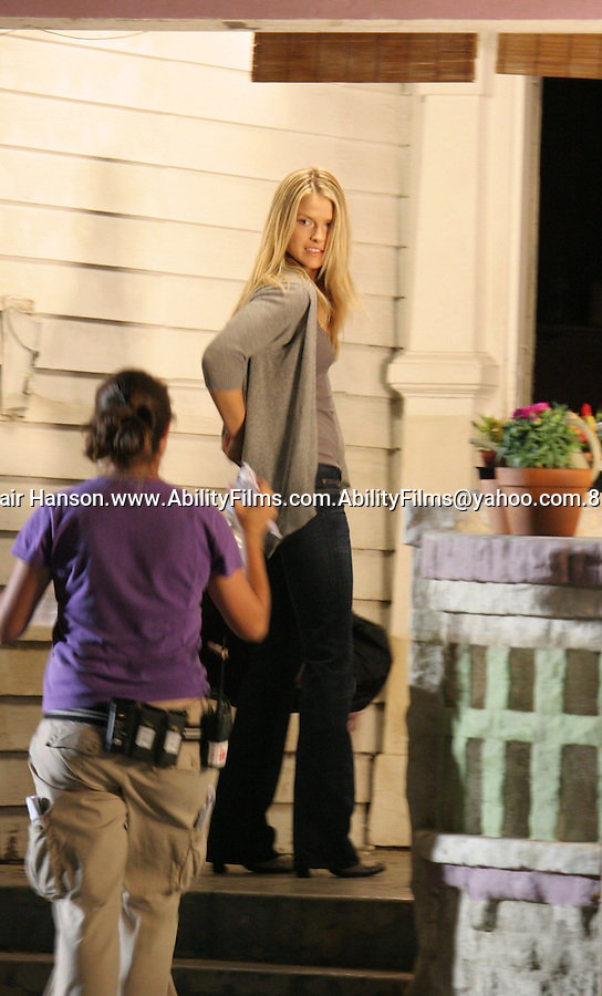 "Ali Larter filming the t.v show ""Heroes"" in Los Angeles Friday night 6-29-07. .She was stretching inbetween takes and dancing around the set. Exclusive"