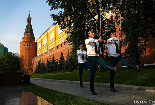 Ceremonial guards march outside Moscow's Kremlin.