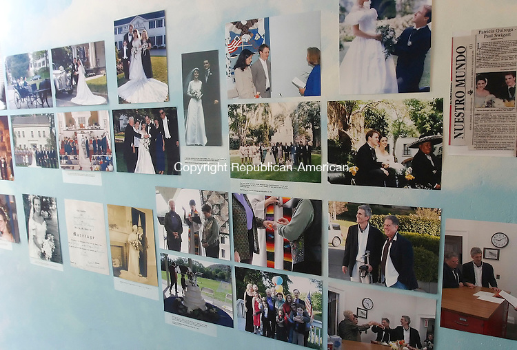 WASHINGTON, CT 06/01/08- 060108BZ10- Dozens of photographs adorn the walls of  the Gunn Museum during a wedding dress exhibition.  <br />  Jamison C. Bazinet Republican-American