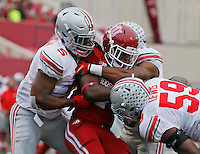 Indiana Hoosiers running back Devine Redding (34) gets stopped by Ohio State Buckeyes linebacker Raekwon McMillan (5) Ohio State Buckeyes safety Vonn Bell (11) Ohio State Buckeyes defensive lineman Tyquan Lewis (59) of the Ohio State Buckeyes against the Indiana Hoosiers at Memorial Stadium in Bloomington Indiana Oct. 3, 2015.(Dispatch photo by Eric Albrecht)