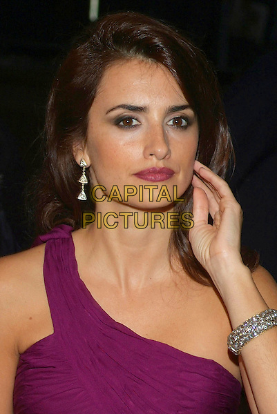 "PENELOPE CRUZ.Attends ""Volver"" Screening at the 2006 Toronto International Film Festival  held at Roy Thomson Hall, Toronto, Ontario, Canada, 08 September 2006..portrait headshot purple dress one shoulder strap diamond bracelet earrings hand touching hair face.Ref: ADM/BP.www.capitalpictures.com.sales@capitalpictures.com.©Brent Perniac/AdMedia/Capital Pictures."
