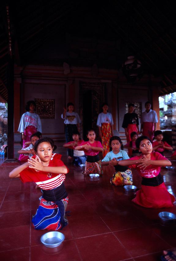 Young Balinese dancers rehearse, Ubud, Bali, Indonesia