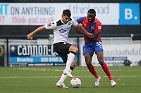 Joe Quigley of Bromley shields the ball from Dagenham's Manny Onariase during Bromley vs Dagenham & Redbridge, Vanarama National League Football at the H2T Group Stadium on 24th November 2018