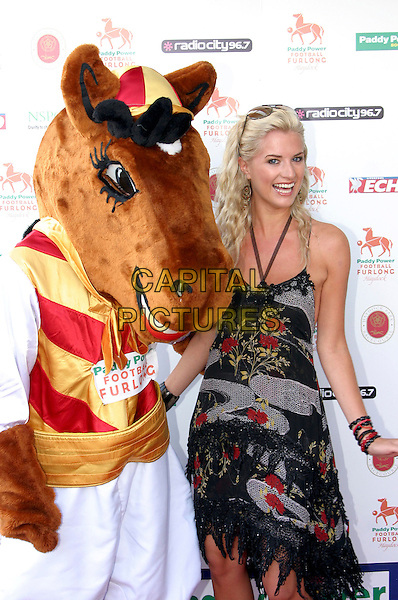 SARAH DUNN.Members of the Hollyoaks cast at Paddy Power Football Furlong, Haydock Park race course, Near Liverpool, .Sunday 10th July 2005..half length funny horse toy costume dressed up.Ref: JEZ.www.capitalpictures.com.sales@capitalpictures.com.©Jez Self/Capital Pictures