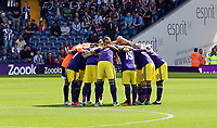 Pictured: Swansea players huddle before kick off.<br />