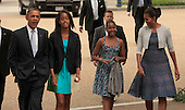 The Obamas walk from the White House to St. John's Episcopal Church on August 19, 2012.  (left to right: United States President Barack Obama, Malia Obama, Sasha Obama, and first lady Michelle Obama)  .Credit: Dennis Brack / Pool via CNP