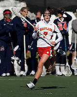 Katie Schwarzman (7) of Maryland sprints upfield at the practice turf field in College Park, Maryland.  Maryland defeated Richmond, 17-7.
