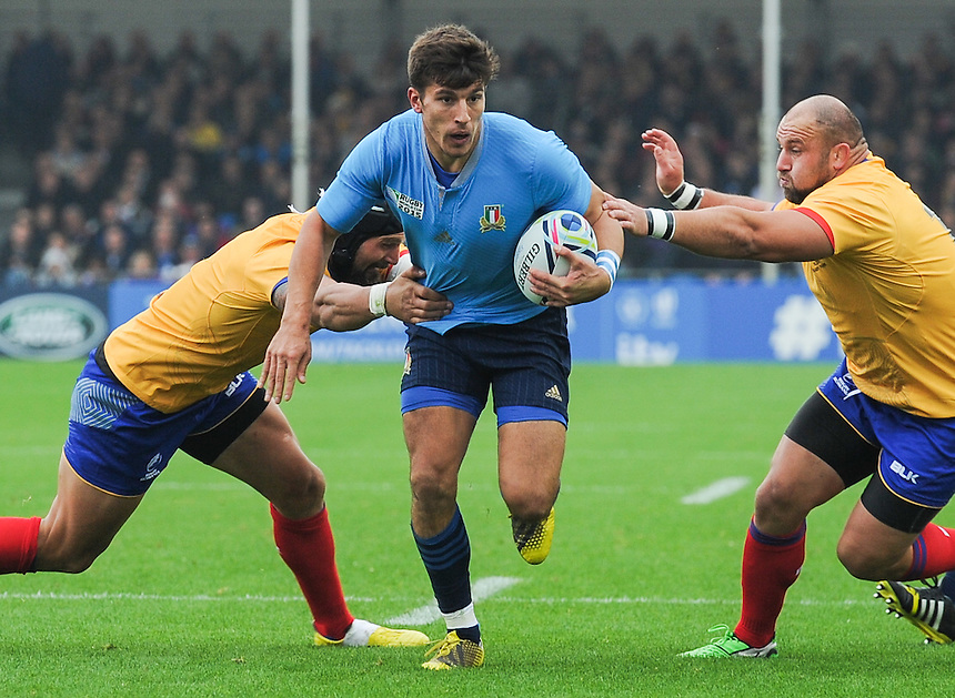 Italy's Tommaso Allan is tackled by Romania's Valentin Ursache and Andrei Ursache<br /> <br /> Photographer Craig Thomas/CameraSport<br /> <br /> Rugby Union - 2015 Rugby World Cup Pool D - Italy v Romania - Sunday 11th October 2015 - Sandy Park, Exeter <br /> <br /> &copy; CameraSport - 43 Linden Ave. Countesthorpe. Leicester. England. LE8 5PG - Tel: +44 (0) 116 277 4147 - admin@camerasport.com - www.camerasport.com