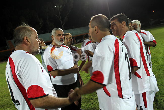 Palestinian prime minister in Gaza Strip, Ismail Haniya participate in football match in solidarity with prisoners jailed in Israel in front of the International Red Cross building in Gaza City, Wednesday, Oct. 12, 2011. According to an Israeli Prison Service statement released Sunday, over 200 Palestinian prisoners are currently hunger striking in Israeli prisons, in protest against the worsening of their prison conditions. Palestinian officials said around 2,000 prisoners have joined the strike, demanding better conditions behind bars. Photo by Mohammed Asad