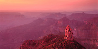 935000009 panoramic view -  dawn light filters through a high cloud layer over the north rim of the grand canyon and turns mount hayden and surrounding canyons diffused pink and purple