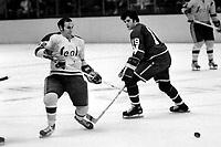 Seals Gary Jarrett with Vancouver Canucks Richard Lemieux. (1971 photo/Ron Riesterer)