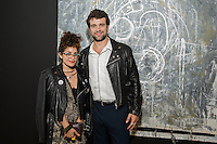 Nathaly Charria and Christopher Hines attend the COMMUNION Group Show on Friday, June 24, 2016 (Photo by Inae Bloom/Guest of a Guest)
