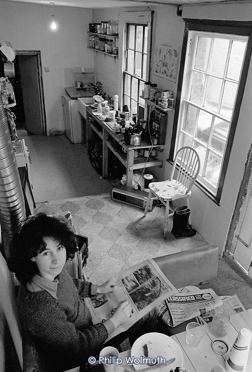 Maeve in the kitchen of 19 Carol Street, one of a row of squatted houses in Camden Town, London, which was later granted short-life status and subsequently became a council-supported housing co-operative.