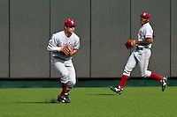 AUSTIN, TEXAS-March 5, 2011:  Center Fielder Jake Stewart of Stanford fields a ball while Austin Wilson backs up during the game against the Texas Longhorns, at Disch-Falk field in Austin, Texas.  Stanford defeated Texas 9-2.