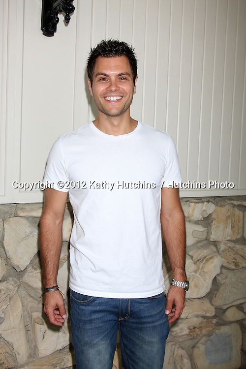 LOS ANGELES - JUL 21:  Eric Valdez arrives at the 2012 General Hospital Fan Club Luncheon at Sportsman's Lodge  on July 21, 2012 in Studo City, CA
