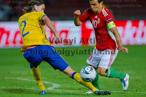 Sweden's Mikael Lustig (L) and Hungary's Tamas Hajnal (R) fights for the ball during the UEFA EURO 2012 Group E qualifier Hungary playing against Sweden in Budapest, Hungary on September 02, 2011. ATTILA VOLGYI
