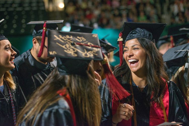Sophia Ciancone (Right) talks with friends at undergraduate commencement. Photo by Ben Siegel