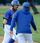 SIOUX FALLS, SD, MAY 20:  Cameron Monger #20 from the Sioux Falls Canaries gets is congratulated by the first base coach after a solo home run in the fourth inning against the Sioux City Explorers Friday night at the Sioux Falls Stadium. (Photo by Dave Eggen/Inertia)