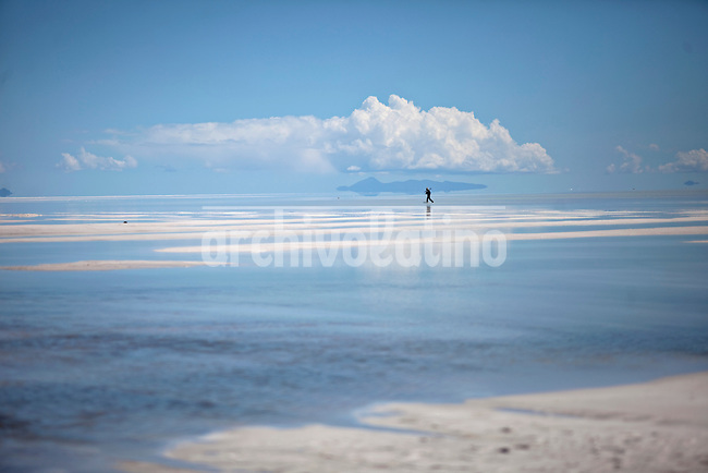 """Uyuni Salt Flats, Bolivia<br /> April 19, 2012<br /> A view of man walking in the Uyuni Salt Flats, the largest salt desert in the world and one of the main attractions for the Dakar 2014 next January.  ©PATRICIO CROOKER/ARCHIVO LATINO For  the first time in its history,  in January 2014 the Dakar Rally will  be cross part of Bolivia, one of the wildest South American nations.  """"The organizers of the Dakar, attracted by the discovery of new spaces, were conquered by Bolivian landscapes that can be classified among the most striking of the continent,"""" says the official site of the international race.<br /> The most impressive is the section that runs through the Salar of Uyuni,  considered the world's largest salt flat and a place of surreal beauty, almost otherworldly.<br /> The competition is scheduled for  in January 2014. Our photographer and  friend Patricio Crooker  show us  the unique beauty of the places the rally will hit."""