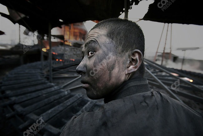 Workers in the factories have no immunity defenses. They get ill after one or two years on the job. Wuhai City, Inner Mongolia.  April 10, 2005.
