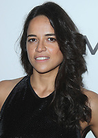 BEVERLY HILLS- OCTOBER 13:  Michelle Rodriguez at amfAR Los Angeles 2017 at Ron Burkleâs Green Acres Estate on October 13, 2017 in Beverly Hills, California. (Photo by Scott Kirkland/PictureGroup)