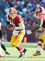 Washington Redskins quarterback Kirk Cousins (8) hands-off to running back Matt Jones (31) in the third quarter against the Philadelphia Eagles at FedEx Field in Landover, Maryland on Sunday, October 16, 2016.<br /> The Redskins won the game 27 - 20.<br /> Credit: Ron Sachs / CNP /MediaPunch