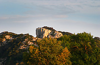 A white rock hill top with garrigue bushes in the region of Chateauneuf. Bouches du Rhone, France Europe