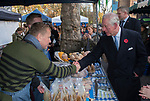 Fosse Meadows Farm free range chickens  producers. London Farmers Market 20th anniversary, November 2019. Prince Charles introduced to farmers Nick Ball and Jacob Sykes on their stand at the Swiss Cottage farmers market London.