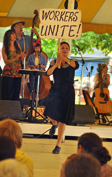 "Livia Drapkin Vanaver, of the Vanaver Caravan Dance troupe, dancing during the group's performance of,  ""Pastures of Plenty: Tribute to Woody Guthrie"" on the Dance Stage of the 2012 Clearwater Festival at Croton Point Park on Sunday, June 17, 2012. Photograph taken by Jim Peppler. Copyright Jim Peppler/2012."