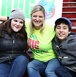 Ryann Redmond and Laura Heywood, aka @BroadwayGirlNYC, and Anthony Rosenthal attend Big Hug Day: Broadway comes together to spread kindness and raise funds for Children's Hospitals on January 21, 2018 at Duffy Square, Times Square in New York City.
