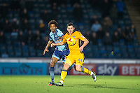Aaron Williams of Newport County & Sido Jombati of Wycombe Wanderers during the Sky Bet League 2 match between Wycombe Wanderers and Newport County at Adams Park, High Wycombe, England on 2 January 2017. Photo by Andy Rowland.