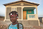 Cherlyna Joseph, 6, walks to school early in the morning. She lives in a new house built by Servicio Social de las Iglesis Dominicanas in the Haitian community of Ganthier. SSID, a member of the ACT Alliance, has worked extensively in the community since it was devastated in 2016 by Hurricane Matthew.