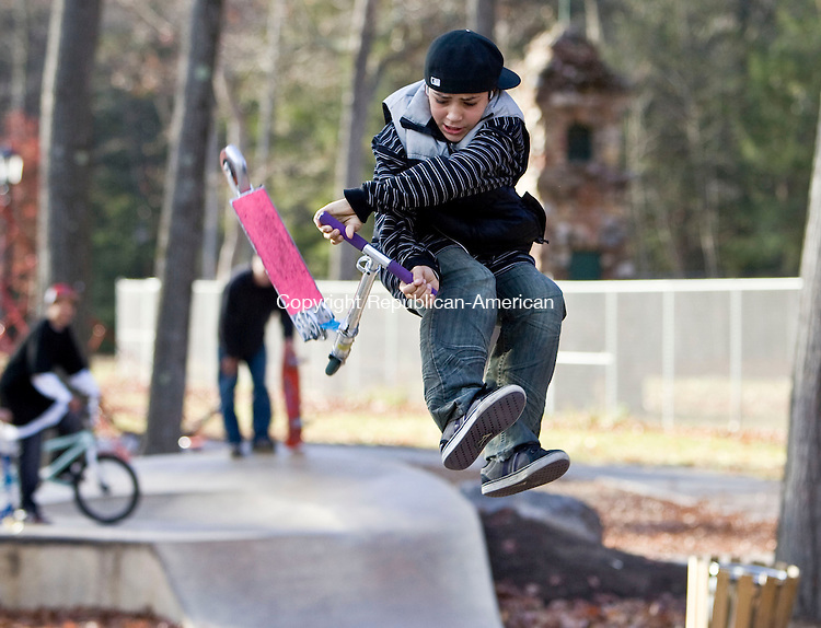 BRISTOL, CT - 02 NOVEMBER 2009 -110209JT03-<br /> Izzy Ramos, 14, of Bristol, flips his scooter in the air while at Rockwell Park Skate Plaza in Bristol on Monday.<br /> Josalee Thrift Republican-American
