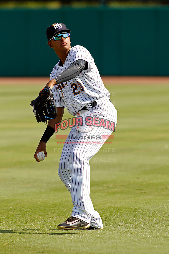 "Charleston Riverdogs outfielder Leonardo Molina (20) throwing in the outfield before a game against the Hickory Crawdads at the Joseph P. Riley Ballpark in Charleston, South Carolina. For Sunday games, the Riverdogs wear their ""Holy City"" uniforms in honor of the city's nickname. Hickory defeated Charleston 8-7. (Robert Gurganus/Four Seam Images)"