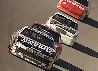 Phil Parsons 55 Ken Schrader 25 Larry Pearson 16 Dale Jarrett 29 action Winston 500 at Talladega Superspeedway in Talladega , AL in May 1989.  (Photo by Brian Cleary/www.bcpix.com)