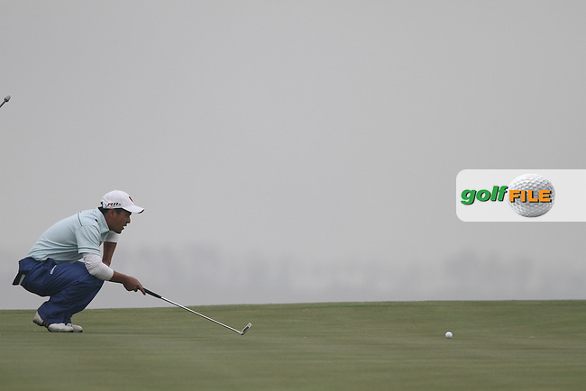 Gu Cul-lin (CHN) on the 16th on Day 2 of the 2012 Volvo China Open at Binhai Lake Golf Club, Tianjin, China...(Photo Jenny Matthews/www.golffile.ie)