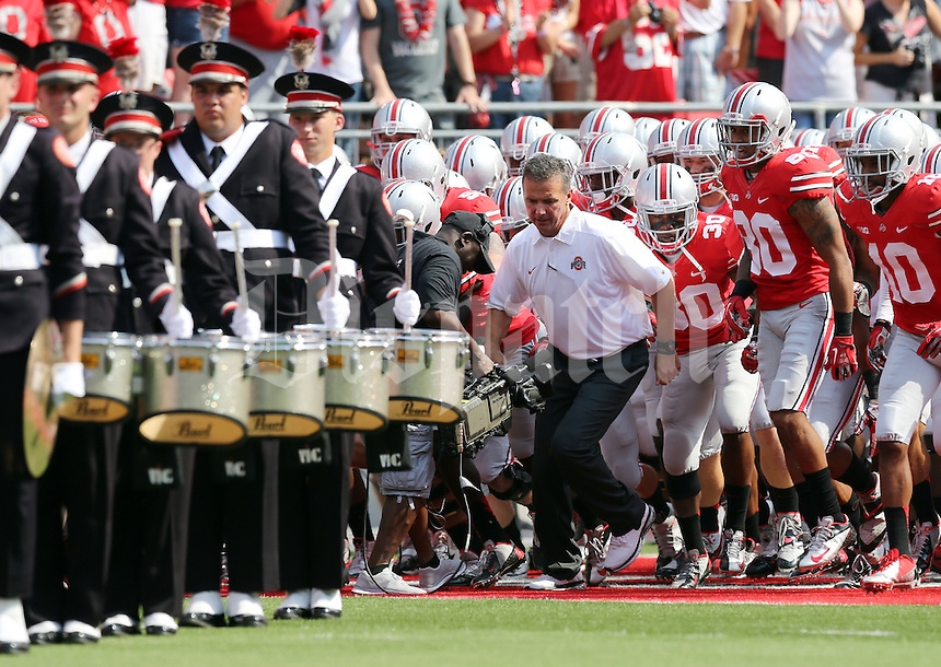 Ohio State Buckeyes head coach Urban Meyer leads the team onto the field prior to the NCAA football game against San Diego State at Ohio Stadium in Columbus on Sept. 7, 2013. (Adam Cairns / The Columbus Dispatch)