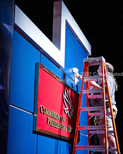 Unidentified worker cleans the wall prior to the First 2012 Presidential Debate at the University of Denver in Denver Colorado on Tuesday, October 2, 2012..Credit: Ron Sachs / CNP.(RESTRICTION: NO New York or New Jersey Newspapers or newspapers within a 75 mile radius of New York City)