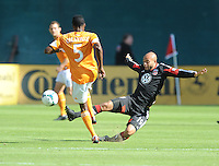 Kyle Porter (19) of D.C. United goes against Warren Creavalle (5) of the Houston Dynamo. The Houston Dynamo defeated D.C. United 2-1, at RFK Stadium, Saturday October 27, 2013.