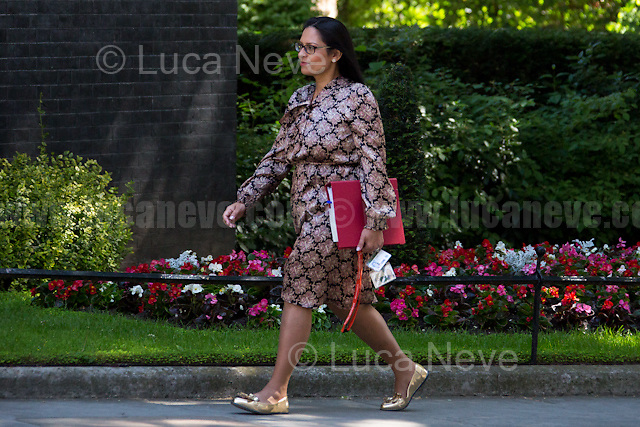 Priti Patel MP (Secretary of State for International Development).<br /> <br /> London, 15/06/2017. Today, the British Prime Minister, Theresa May, meets the political parties of Northern Ireland - Alliance Party, Ulster Unionist Party, Social Democratic and Labour Party (SDLP), Sinn Fein, Democratic Unionist Party (DUP) - while she is trying to form her new minority Conservative government in coalition with the Democratic Unionist Party (DUP - http://bit.ly/2s93eHf), the largest unionist political party in Northern Ireland. Earlier, Theresa May left Downing Street to pay a visit to the Grenfell Tower in Kensington which was destroyed during the night by a a huge fire causing numerous victims (To see my story &quot;Fire at Grenfell Tower - Aftermath of a Disaster&quot; click here: http://bit.ly/2rESn90 ). Then, the Prime Minister came back to Downing Street to chair the Cabinet Meeting. <br /> After 5 years of the Coalition Government (Conservatives &amp; Liberal Democrats) led by the Conservative Party leader David Cameron, and one year of David Cameron's Government (Who resigned after the Brexit victory at the EU Referendum held in 2016), British people voted in the following way: the Conservative Party won 318 seats (42.4% - 13,667,213 votes &ndash; 12 seats less than 2015), Labour Party 262 seats (40,0% - 12,874,985 votes &ndash; 30 seats more then 2015); Scottish National Party, SNP 35 seats (3,0% - 977,569 votes &ndash; 21 seats less than 2015); Liberal Democrats 12 seats (7,4% - 2,371,772 votes &ndash; 4 seats more than 2015); Democratic Unionist Party 10 seats (0,9% - 292,316 votes &ndash; 2 seats more than 2015); Sinn Fein 7 seats (0,8% - 238,915 votes &ndash; 3 seats more than 2015); Plaid Cymru 4 seats (0,5% - 164,466 votes &ndash; 1 seat more than 2015); Green Party 1 seat (1,6% - 525,371votes &ndash; Same seat of 2015); UKIP 0 seat (1.8% - 593,852 votes); others 1 seat. <br /> <br /> The definitive turn out of the election was 68.7%, 2% higher than the 
