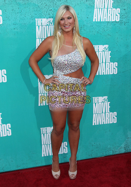 Brooke Hogan.2012 MTV Movie Awards held at the Gibson Amphitheatre, Universal City, California, UA..June 3rd, 2012.full length dress cut out away top skirt hands on hips silver one shoulder sheer embellished jewel encrusted  .CAP/ADM/RE.©Russ Elliot/AdMedia/Capital Pictures.