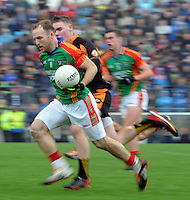 26-10-2014:Darran O'Sullivan,  Mid Kerry, breaks away from Greg Horan, Austin Stacks,  in the Kerry senior football County Championship final at Austin Stack Park, Tralee on Sunday.  Picture: Eamonn Keogh ( MacMonagle, Killarney)