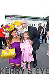 STYLE QUEEN: Carol Kennelly, Tralee, who took home the title of Best Dressed Lady at the Galway Races Ladies Day on Thursday last pictured with her daughter.Rosie and Husband Kerry.