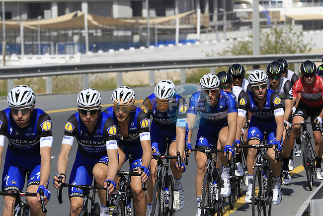 The peloton with Etixx-Quick Step driving the pace on the front pass by Dubailand during Stage 2, the Nakheel Stage, of the 2016 Dubai Tour starting at the Dubai International Marine Club and running 188km to Palm Jumeirah Atlantis, Dubai, United Arab Emirates. 4th February 2016.<br /> Picture: Eoin Clarke | Newsfile<br /> <br /> <br /> All photos usage must carry mandatory copyright credit (&copy; Newsfile | Eoin Clarke)