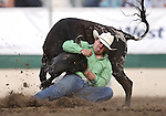 Dirk Tavenner competes in the steer wrestling event at the Reno Rodeo in Reno, Nev. on Friday, June 19, 2015.<br /> Photo by Cathleen Allison/Nevada Photo Source