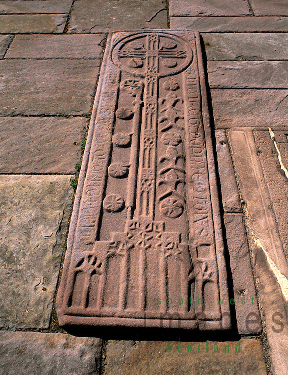 The Cistercian abbey of Dundrennan 12th centuary a highly decorated grave slab of a Abbot in the Chapter House near Kirkcudbright Scotland UK