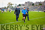 Referee Seamus Mulvihill is escorted off the field by Gardai after the County Championship final on Sunday