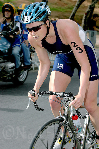 25 OCT 2003 - VOUGLIAMENI, ATHENS, GREECE - Jodie Swallow (GBR) climbs a hill on the cycle course at the ITU World Cup race. (PHOTO (C) NIGEL FARROW)