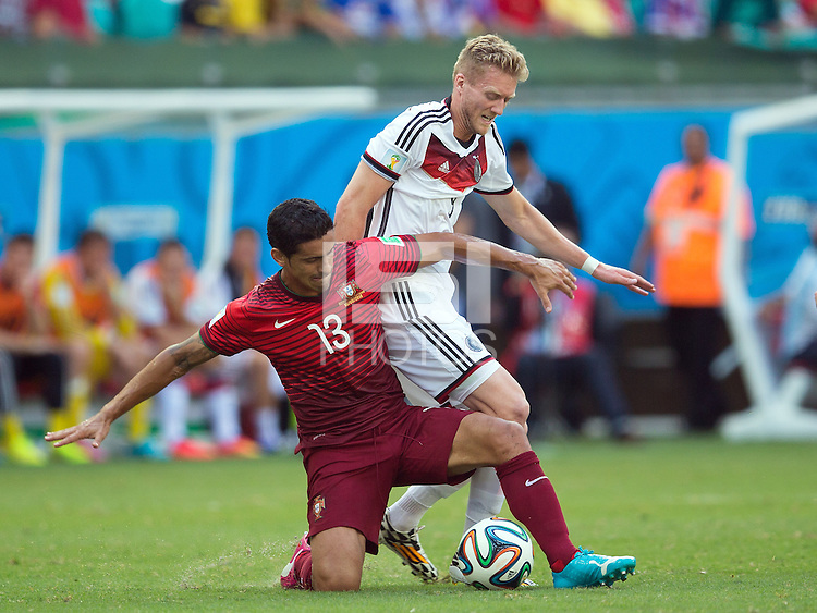 Ricardo Costa of Portugal and Andre Schurrle of Germany